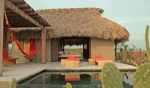 a secluded beach hut village on mexico u0027s coast design milk