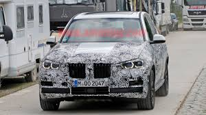 bmw x5 headlights bmw x5 spied with production spec headlights and grille