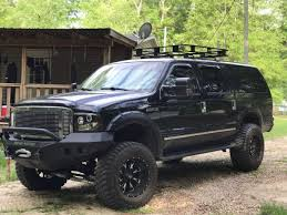 nissan titan on 28s 2005 ford excursion limited 4x4 with road armor bumpers and 37 u0027s
