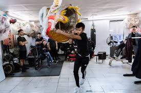 lion dancer book a club where lions and traditions take root the new york times