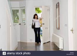 portrait of young thirty something wife and mother coming home to