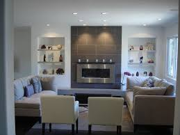 a clean contemporary living room featuring a wall mounted gas a clean contemporary living room featuring a wall mounted gas burning fireplace accented with floor