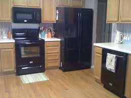what color cabinets go with black appliances granite countertop with oak cabinet pictures kitchen tile ideas