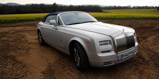 roll royce wood opposites attract rolls royce phantom drophead versus bmw i3