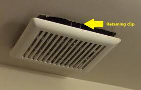 bathroom is it normal for an exhaust fan cover to hang below the