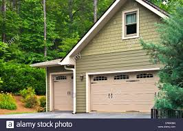 garage doors on a modern house double doors with windows on one