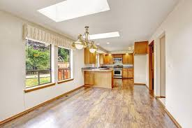 empty house with open floor plan living room and kitchen area
