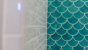 blue moroccan fish scale tile complimented by white subway tile