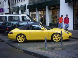 yellow porsche 911 file yellow porsche 911 carrera cabriolet type 996 jpg wikimedia