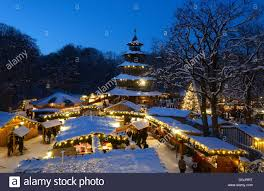 christmas market at chinese tower english garden stock photos