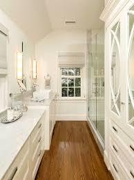 galley bathroom ideas space white cabinetry wood flooring bath design bathroom ideas