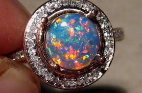 white opal meaning best black opal engagement rings for you