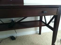 dark wood belmont writing desk with hideaway power outlet station