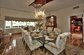 traditional dining room with bay window u0026 terracotta tile floors