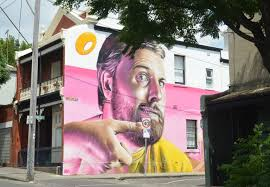 mural on wood smug on wood melbourne on the streets