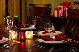 elegant dining room table decked out for christmas dinner stock