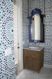 bathroom with moroccan mirror featured blue frames bold and