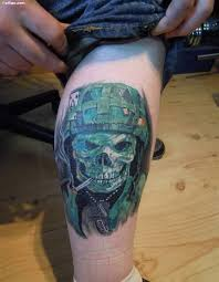 collection of 25 sword skull tattoos on back of thigh