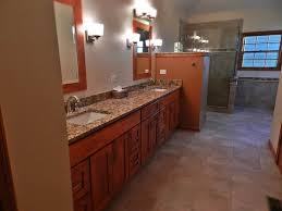 bathroom walnut bathroom cabinet design ideas with wall sconce