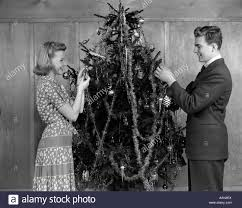 christmas tree tinsel 1940s decorating christmas tree with tinsel and ornaments