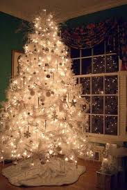 white tree with white lights happy holidays