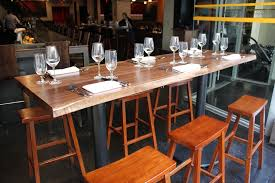 handmade live edge bar tables by peter lawrence woodworkers