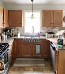 how to paint kitchen cabinets brown painting your builder grade kitchen cabinets renovating