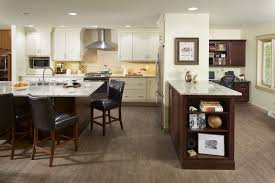 two tone kitchen has massive island and home office