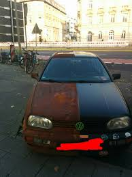 rusty car vw golf with rusty finish looks like two face is perfect for