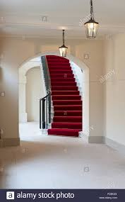 red carpet and staircase in kensington palace london uk stock