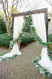 wedding arch no flowers confetti skies event design confetti and wedding