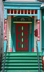 amazing red door contrast the green wodoen entryway modern red