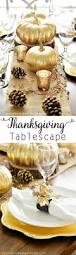 thanksgiving inspired gold table decor dinner party a pumpkin