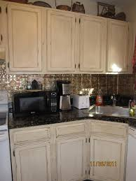 distressed white kitchen cabinets lori caromal colour s her oak kitchen cabinets fabulously finished