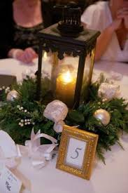 Wedding Centerpiece Lantern by Mercy Not The Left Side Mantle But Some Lanterns With Greenery