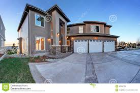 exterior luxury house exterior with three car garage and driveway