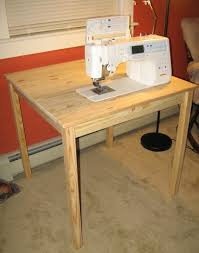 cheap sewing machine cabinets blue dinosaurs blog i m back diy sewing table