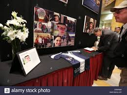 memorial service sign in book us diplomats and service members sign a condolence book during a