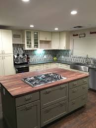 napa ca contractor remodels mom and dad s kitchen two tone green and white kitchen design includes large cooktop island with pot and pan storage