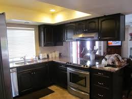 limestone backsplash kitchen dark brown laminated wooden wall mounted kitchen cream color