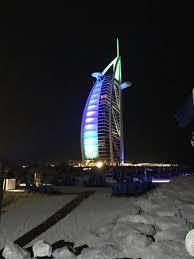 burj al arab by night picture of jumeirah beach hotel dubai