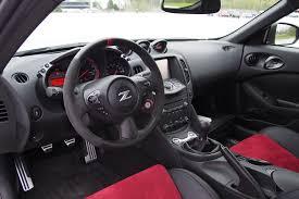 Nissan 370z Interior 2015 Ford Mustang Gt Vs 2015 Nissan 370z Nismo Autoguide Com News