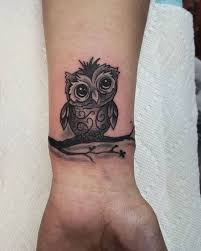 collection of 25 owls tattoos on wrist