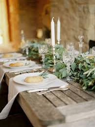 picture of rustic table decor with bread and eucalyptus candles