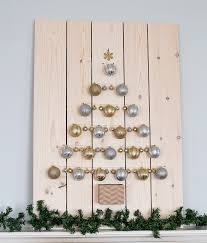 silver and gold ornament tree display domestically speaking