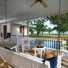 forever home rebuilding after hurricane katrina coastal living the symmetrical wraparound porch has a traditional haint blue wood ceiling which was screwed into