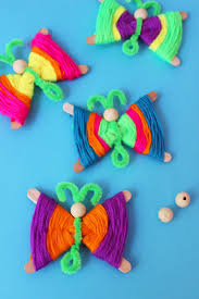 popsicle stick butterflies how to make colorful yarn butterflies