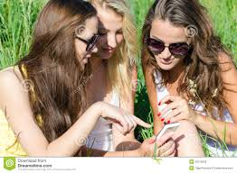 Teen Girl Sending Text Message On Her Mobile Phone In Urban