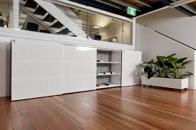 office storage cabinets with doors and shelves sliding door cabinets by filing systems international a division of