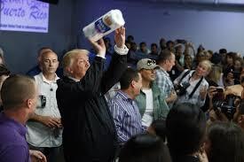 trump defends tossing paper towels cnn video